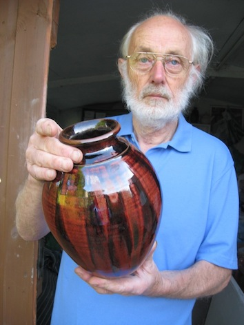 Maxwell Cowlin holding one of his pots